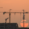 January 11th - The sun is setting behind the Palm Jumeirah but the cranes continue to work into the night.