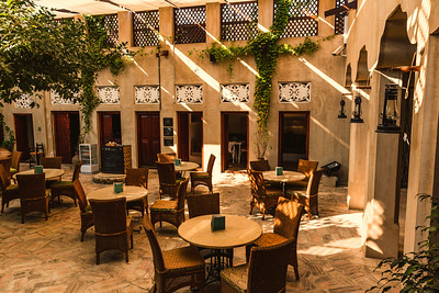 Outdoor courtyard and restaurant at the XVA Hotel, Dubai, UAE