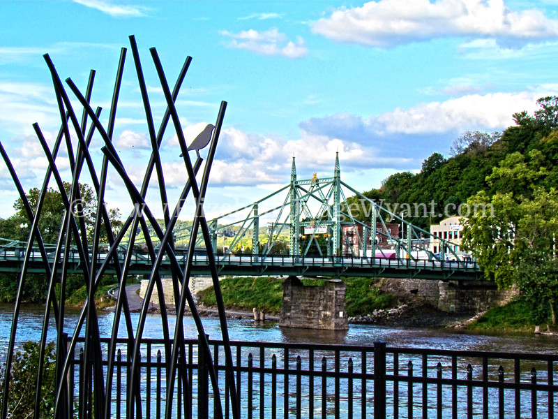"The Northampton Street Bridge was designed by James Madison Porter III and built in 1896. It provides access between New Jersey and Pennsylvania. Major renovations were required after flooding brought on by Hurricane Diane in 1955 washed out the center section. A Bailey bridge was installed while repairs were made. Celebrating its 100th birthday in 1996, the ""free bridge"" (there is no toll to cross), with its Gothic detail, is the last of its type in the United States and is a National Civil Engineering landmark.<br /> Easton, PA 9/20/2012"