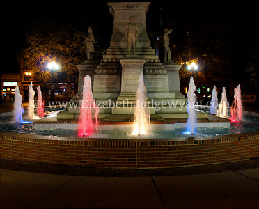 "Lighted Fountain, Centre Square, Easton, PA The Great Square has been the site of the oldest, continuously operated outdoor Farmers Market since 1792. It is also the site where Robert Levers read the Declaration of Independence to the gathered public on July 8, 1776, standing on the steps of the courthouse. The Civil War Monument that now stands on the old courthouse site, is a 75 foot tall obelisk topped by  ""The Bugler."" Formally named the Soldiers' & Sailors' Monument was dedicated to local veterans in 1900. Each year, the monument is shrouded by a one hundred foot Peace Candle, which is ceremoniously lighted the Friday evening after Thanksgiving.  Easton, PA 4/20/2013"
