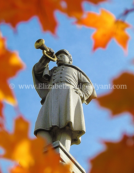 """Fall Bugler, Easton PA <br /> The Great Square has been the site of the oldest, continuously operated outdoor Farmers Market since 1792. It is also the site where Robert Levers read the Declaration of Independence to the gathered public on July 8, 1776, standing on the steps of the courthouse. The Civil War Monument that now stands on the old courthouse site, is a 75 foot tall obelisk topped by  """"The Bugler."""" Formally named the Soldiers' & Sailors' Monument was dedicated to local veterans in 1900. Each year, the monument is shrouded by a one hundred foot Peace Candle, which is ceremoniously lighted the Friday evening after Thanksgiving. <br /> Easton, PA 10/17/2012"""