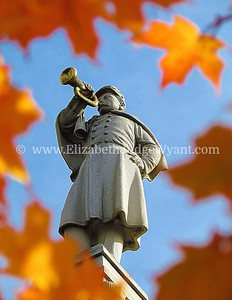 "Fall Bugler, Easton PA  The Great Square has been the site of the oldest, continuously operated outdoor Farmers Market since 1792. It is also the site where Robert Levers read the Declaration of Independence to the gathered public on July 8, 1776, standing on the steps of the courthouse. The Civil War Monument that now stands on the old courthouse site, is a 75 foot tall obelisk topped by  ""The Bugler."" Formally named the Soldiers' & Sailors' Monument was dedicated to local veterans in 1900. Each year, the monument is shrouded by a one hundred foot Peace Candle, which is ceremoniously lighted the Friday evening after Thanksgiving.  Easton, PA 10/17/2012"