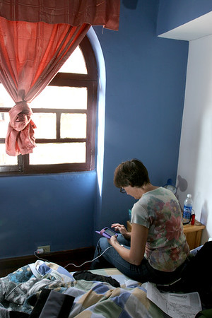 "Deb is checking email and facebook from our room at Hostel Revolution.  We were able to ""keep connected"" via the internet using our iPods for almost all of our trip.  I also used Skype to make phone calls... well, at least until the mic on my headset went toes up!  It was great to have even for a little while."