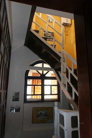 Hostel Revolution has three stories and access to a rooftop patio.  This image shows the stairwell that connects all of the floors.