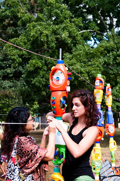 Volunteers setting up Laundry Bottle Totems at Elm Park