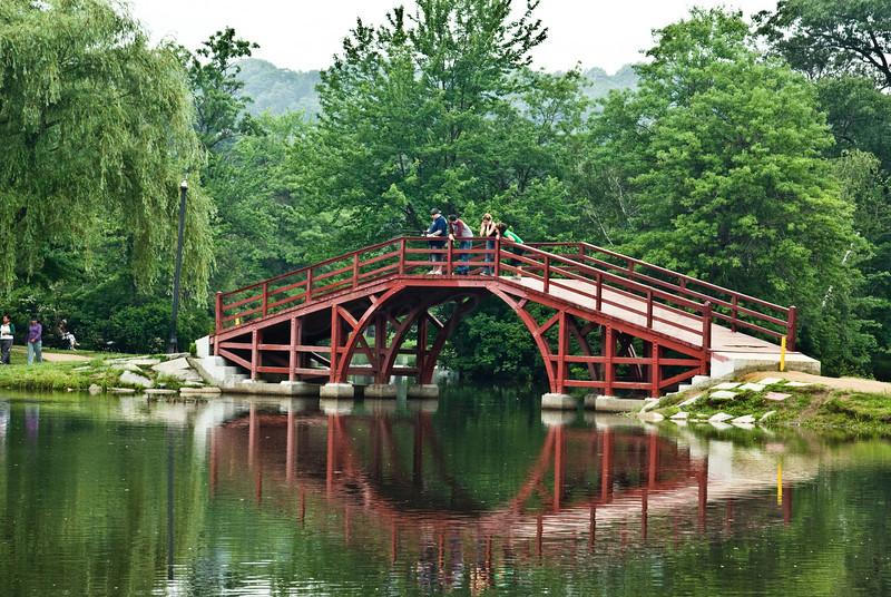 Locals fishing off the wooden bridge.