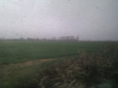 English countryside through a dirty train window
