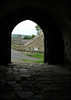 Village of Castle Bolton framed in arched door - Castle Bolton, England