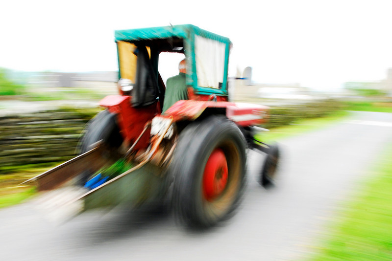 Farmer whizzing by on a tractor - Castle Bolton, England
