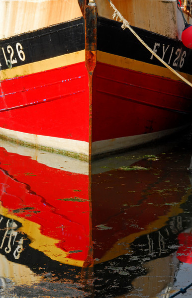 Brightly colored bow reflected in water - Mevagissey, England