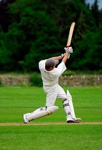Cricket player hits a boundary - Chaddington, England