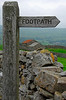 Sign marking Footpath by stone wall - Waldenbeck, England