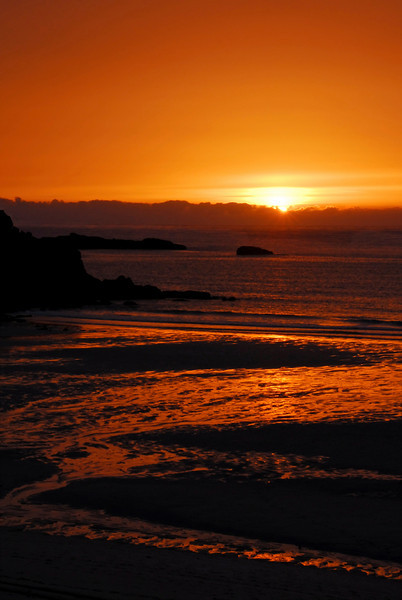 Last blaze of the setting sun on the beach at St. Ives, Cornwall, England
