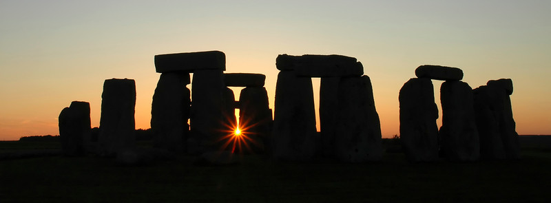 Stonehenge silhouette at sunset with sunburst - England - Letterbox or Banner Format