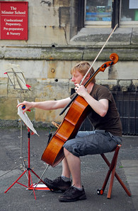 Student cellist performing on the streets of York, England