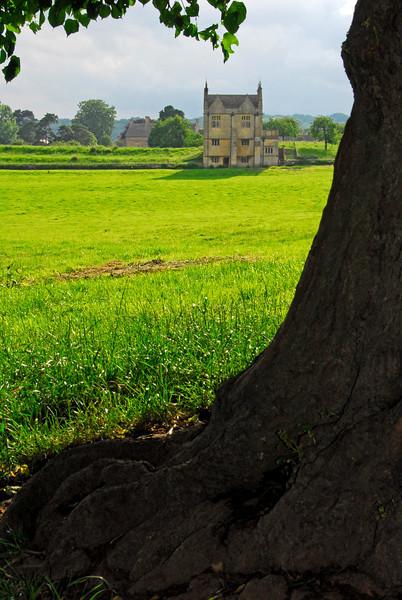 Manor house viewed across green field - Chipping Campden, England