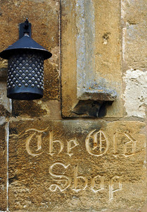 'The Old Shop' carved into Cotswold stone - Great Tew, England