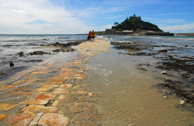Last passage across the cobbled walk to St. Michael's Mount as the tide comes in - Marazion, Cornwall, England