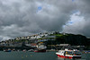 Vessel coming into harbour under moody skies - Mevagissey, England