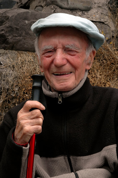 Smiling elderly gentleman in a flat cap - Clovelly, England