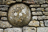 Round stone in stone wall - Great Tew, England