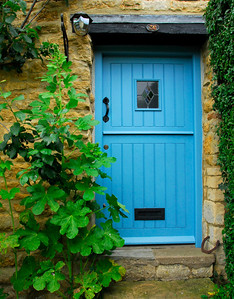 Bright blue door of a Cotswold stone house - Hidcote-Boyce, England