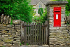 Red English post office box recessed in rock wall - Hidcote-Boyce, England