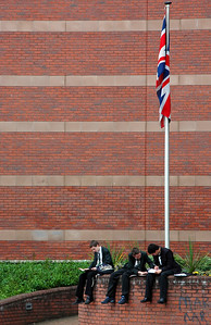 School boys in uniform studying under the UK Flag - Solihull, England