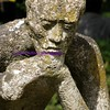 pondering man statue
