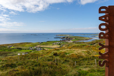 the Sky Road route takes you up among the hills overlooking Clifden Bay and its offshore islands, Inishturk and Turbot.