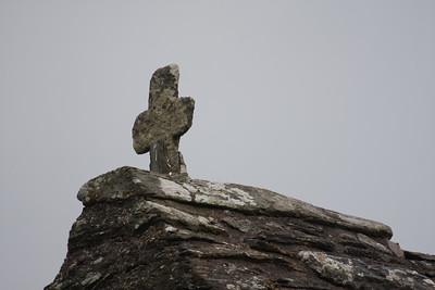 Cross on top of ruined chapel, Glendalough Abbey, Ireland