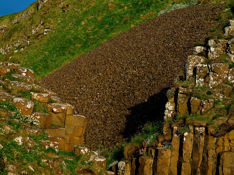 """Talus slope, Giant's Causeway, near Coleraine, Northern Ireland.  A """"talus slope"""" is a large pile of rocky boulders that accumulates at the foot of a cliff, typically by the mechanical-weathering process of frost-wedging.<br /> Photos - © Sean Murphy 2010."""