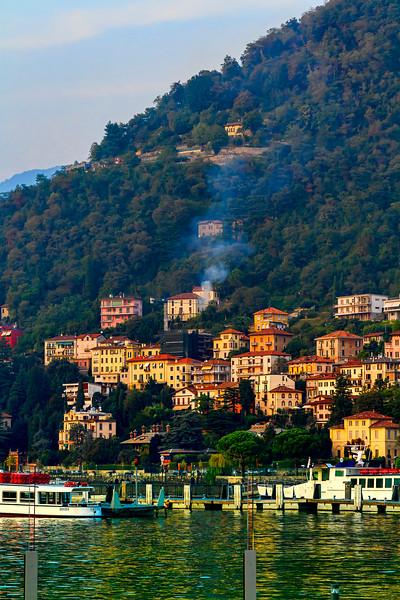 residences rise above Lake Como's shore