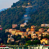 residences rise above Lake Como's shore