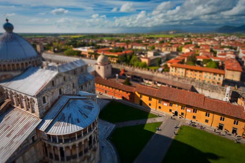 View of the cathedral and nearby down of Pisa, from the leaning tower