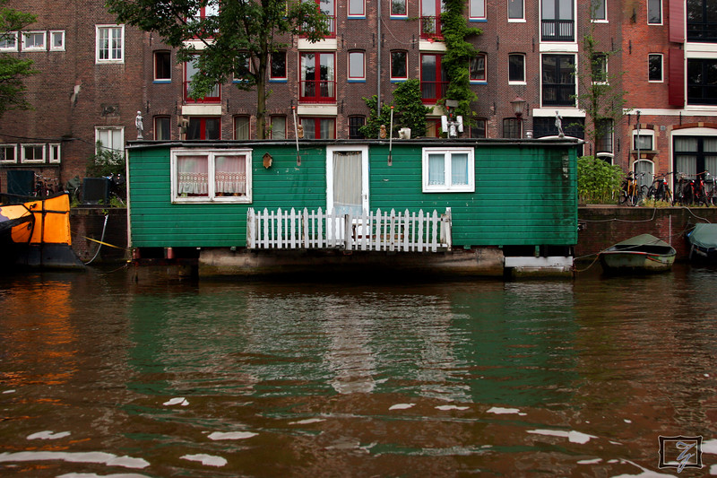 From the canal boat tour you see all sorts of colorful houses.
