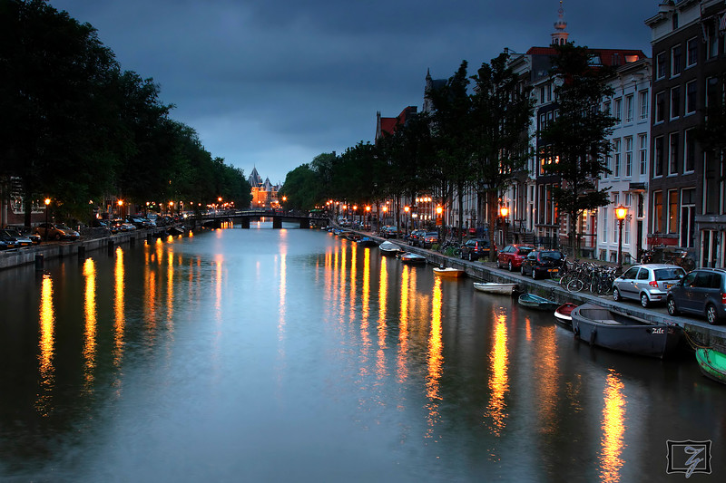 Around midnight, taken from a canal bridge near Kloveniersburgwal.