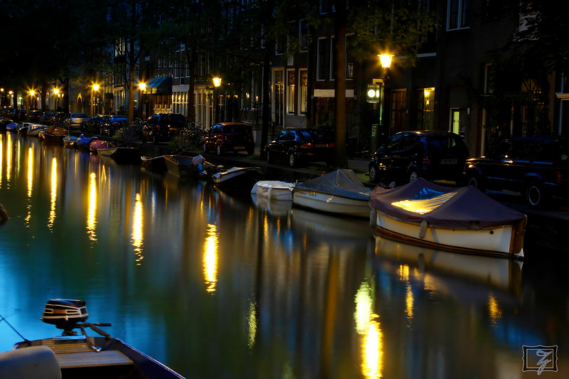 "Late night along one of the smaller canals.<br><br><span class=""subcaption"">A 10-second exposure brings out the sky reflection colors in the canal. To the naked eye on scene, it was all black.</span>"
