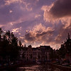 "Early evening over Amsterdam canal.<br><br><span class=""subcaption"">Used Cokin Blue-Yellow polarizer and combined two different images. One exposed for the sky, the other for the canal and houses.</span>"