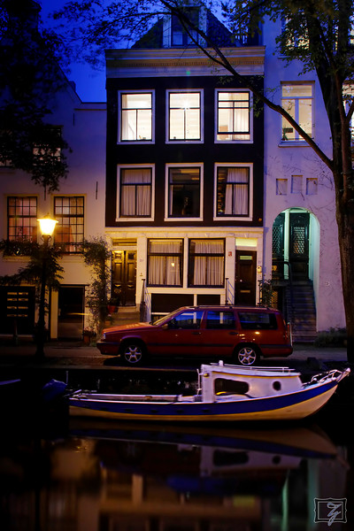 I imagine the typical Amsterdam residence as requiring a car, a boat, and a few bicycles.