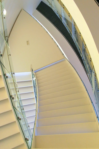 "A separate part of the Van Gogh museum doubles for modern exhibits. The architecture struck me as much as the art, however.<br><br><span class=""subcaption"">This view is from beneath the stairs lookup up.</span>"