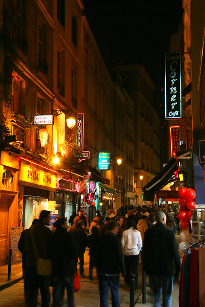 Another typical crowd pushing through the shop-lined Latin Quarter avenues.