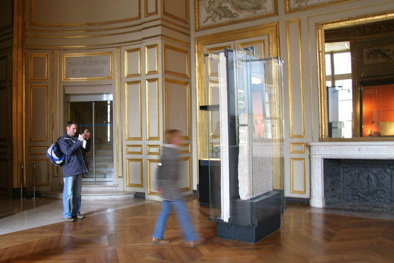 Photographers getting the shot seem motionless compared to the gallery visitors.