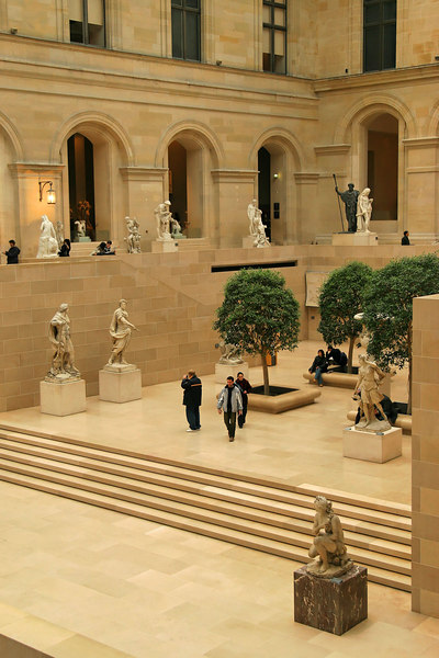 Inside the Louvre a sprawling and roofed court branches in all directions to wings dedicated to each of the major art styles.