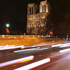 "Notre-Dame at night from a street corner in the Latin Quarter.<br><br><span class=""subcaption"">As I did not take a tri-pod on this trip, I did my best to steady the camera leaning against a street sign and holding my breath. But 1.5 sec. is a stretch.</span>"