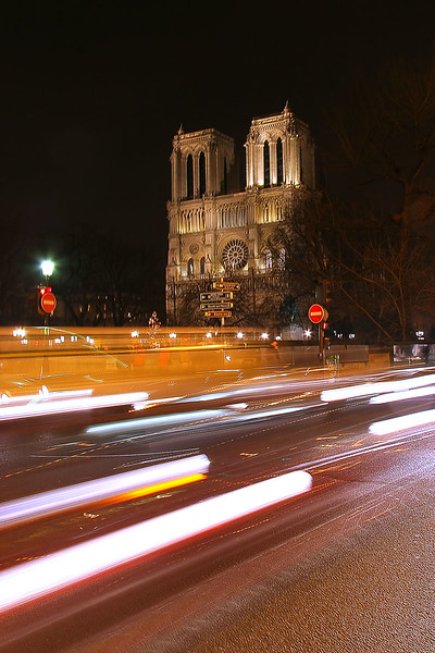 """Notre-Dame at night from a street corner in the Latin Quarter.<br><br><span class=""""subcaption"""">As I did not take a tri-pod on this trip, I did my best to steady the camera leaning against a street sign and holding my breath. But 1.5 sec. is a stretch.</span>"""