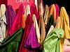 Bolts of silk on the Boulevard de Rochechouart, Montmartre, Paris, France, 20 June 05.