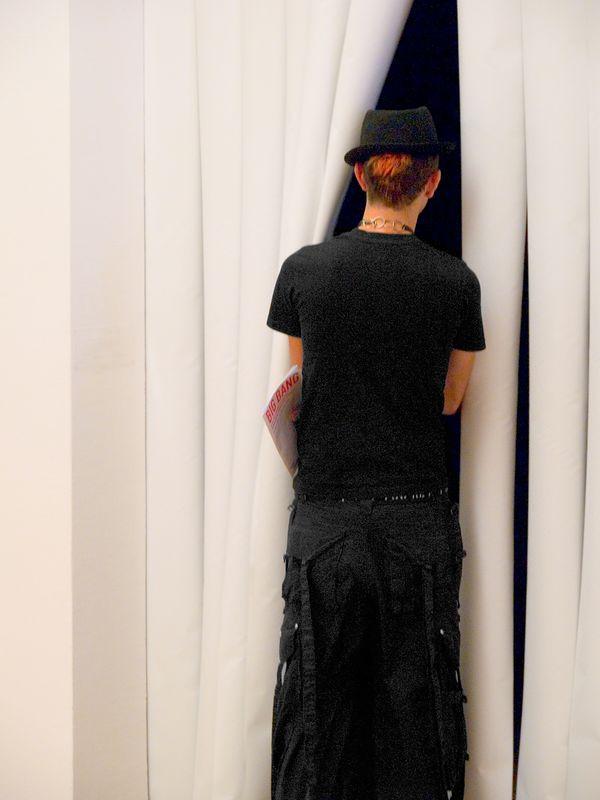 Peeking into the video art room at the  Musée national d'Art moderne - Centre Georges Pompidou, Paris France, 25 June 05.
