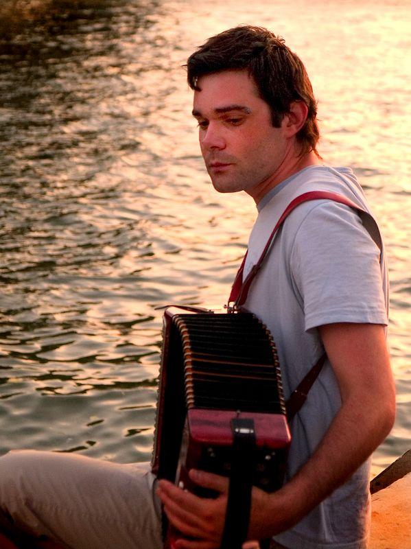 Accordian musician near the Pont Neuf at sunset. (21 Jun 05)