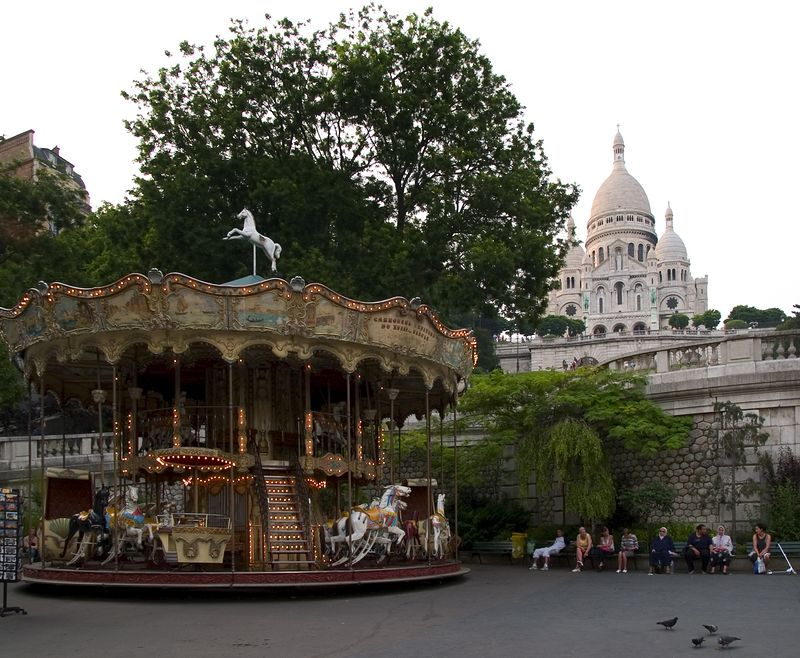 Odd juxaposition of the merry-go-round and the  Basilique du Sacre'-Coeur, Montmartre, (20 June 05)